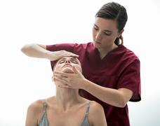 doctor evaluation woman neck - stock photo