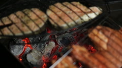 Meat on the grill with flames closeup Stock Footage