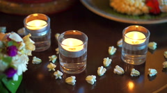 Thai spa accessories setting with candles and herbs - stock footage