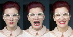 Three different facial expressions of redhaired woman Stock Photos