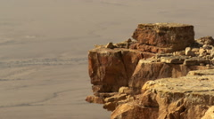 Video of a bird hopping on a cliff edge shot in Israel. Stock Footage