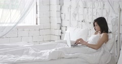 Pretty Young Couple in White Bed Stock Footage