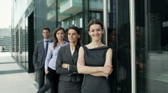 Businesspeople looking to the camera one after another, steadycam shot Stock Footage
