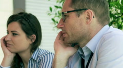 Couple talking with someone in the cafe and chilling, steadycam shot - stock footage