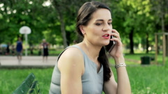 Businesswoman talking on cellphone and checking documents Stock Footage