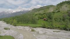 Spring landscape snow mountains and a river Stock Footage