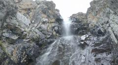 Waterfall, rocks and snowing Stock Footage