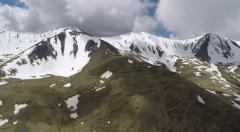 Snowy mountains from helicopter view - stock footage
