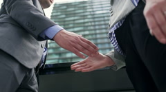 Businesspeople shaking hands because of the agreement, steadycam shot Stock Footage