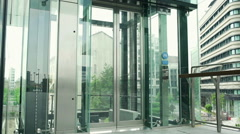 Businesspeople using elevator and walking out, steadycam shot - stock footage