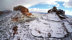 Aerial view of Red Rocks under snow in Sedona, Arizona Stock Footage