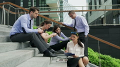 Businesspeople working together on documents, steadycam shot Stock Footage