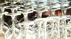 Stock Video Footage of Close-up of empty wine glasses arranged upside down