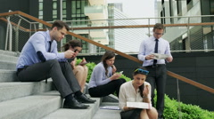Stock Video Footage of Businesspeople sitting in silence and eating lunch, steadycam shot