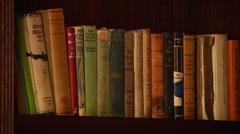 Stock Video Footage of Various books arranged in bookshelf