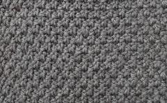 Seed stitch in grey wool - stock photo