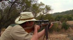 Man shooting with long rifle - stock footage