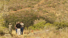 Tourists looking through binoculars at ranch - stock footage