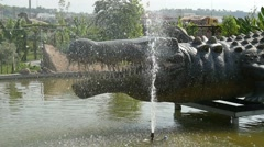 Mock of the dinosaur in the fountain in Discovery Park, Turkey Stock Footage