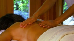 Woman receiving body massage in spa Stock Footage