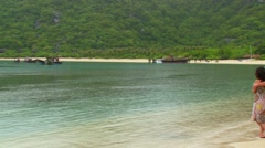 Couples looking at view from beach in Asian Island Stock Footage