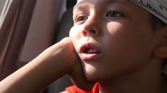 Little boy in car, close-up Stock Footage