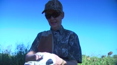 Hunter wearing gloves before dove hunting Stock Footage