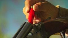 Hunter loading shells in shotgun Stock Footage