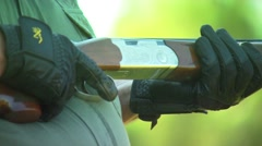 Hunter holding a shotgun in ranch - stock footage