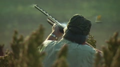 Stock Video Footage of Hunter taking aim and shooting while dove hunting