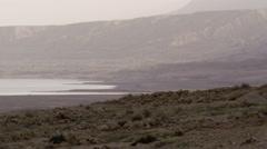 Video of a hazy Dead Sea shoreline shot in Israel. Stock Footage
