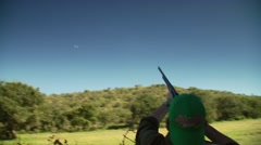 Dove falling in field after being shot by hunter Stock Footage