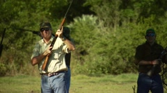 Hunters taking aim and shooting while dove hunting Stock Footage