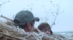 Hunters hiding in hunting blind Stock Footage