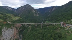 The highest railway bridge in Europe near Kolasin crossing the canyon of Tara Stock Footage