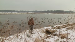 Hunter carrying dead ducks Stock Footage