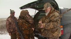 Hunter giving shotgun shells Stock Footage