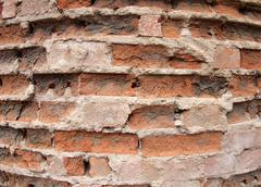 Stock Photo of Closeup of the old wall of the destroyed bricks