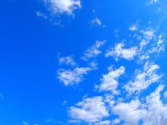 Only the blue sky with white fluffy clouds - stock photo