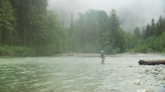 Fly fisher fishing in river Stock Footage