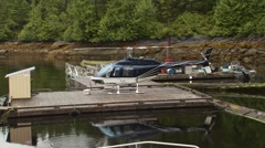 Helicopter parked on wooden dock near riverside Stock Footage
