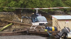 Helicopter taking off from dock Stock Footage