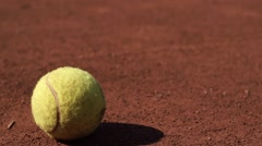 Picking up a tennis ball by foot Stock Footage