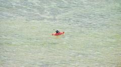 Kayaker on kayak paddling in sea Stock Footage