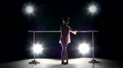 Little Ballerina posing on ballet barre Stock Footage