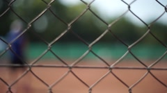 Tennis court behind the fence Stock Footage