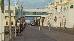 Tourists walking on boardwalk near Trump Taj Mahal Stock Footage