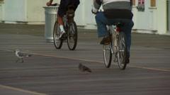 Tourists cycling on boardwalk near Trump Taj Mahal Stock Footage