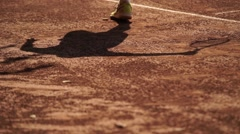 Tennis player shadow on the ground Stock Footage