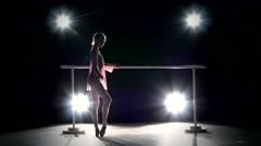 Beautiful little ballerina dancer  on the dance floor Stock Footage